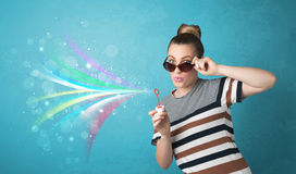 Beautiful girl blowing abstract colorful bubbles and lines Stock Photo