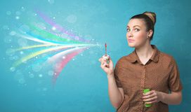 Beautiful girl blowing abstract colorful bubbles and lines Royalty Free Stock Photo