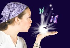 Beautiful girl blowing butterflies - mind reader Royalty Free Stock Photo