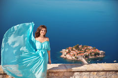 Beautiful Girl in blowing dress. Happy Smiling Young Woman Enjoy Royalty Free Stock Photo