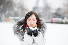 Beautiful girl blowing on snow Royalty Free Stock Image