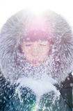 Beautiful girl blowing snow Stock Images