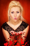 Beautiful girl blows a heart Stock Photography