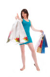 Beautiful girl in the blue bags to shoppers Stock Images