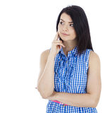 Beautiful girl in a blue blouse thoughtful Royalty Free Stock Photo