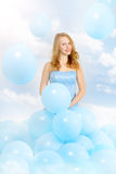 Beautiful girl in a blue dress with balloons Royalty Free Stock Photography