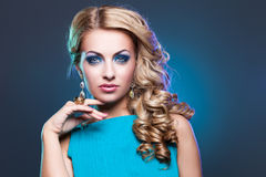 Beautiful girl in blue dress royalty free stock images