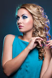 Beautiful girl in blue dress Stock Images