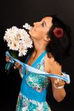 Beautiful girl in the blue dress with flowers Stock Photo