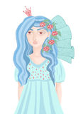 Beautiful girl in a blue dress with flowers in her hair Royalty Free Stock Images