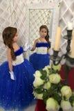 Beautiful girl in blue dress Stock Image