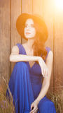 Beautiful girl in blue dress sitting Royalty Free Stock Photography