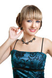 Beautiful girl in blue evening dress. With necklace and earrings royalty free stock photo