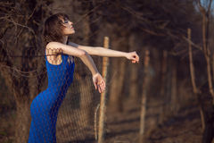 Beautiful girl in blue evening dress. Royalty Free Stock Images