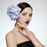 Beautiful girl with blue flowers. Isolate tenderness spring beauty young woman stock photos