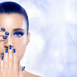 Beautiful Girl in Blue with Hands on Her Face. Nail Art and Make Stock Image