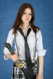 Beautiful girl on blue with japanese sword Royalty Free Stock Photos