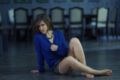 Beautiful girl in a blue outfit Stock Photos