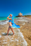 Beautiful girl with blue scarf on the beach Royalty Free Stock Photography