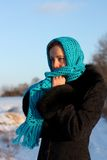 Beautiful girl in a blue scarf cold and lonely Stock Image