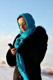Beautiful girl in blue scarf with a mobile phone Stock Photos