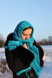 A beautiful girl in a blue scarf thought. Beautiful young girl in a blue scarf and overcoat thought Stock Image