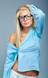 Beautiful girl in blue shirt and glasses Royalty Free Stock Photo
