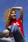 Beautiful girl on a blue sky background Stock Images