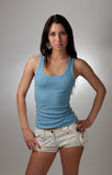 A beautiful girl in a blue t-shirt with a gray bac Royalty Free Stock Images