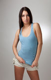 A beautiful girl in a blue t-shirt with a gray bac Stock Images
