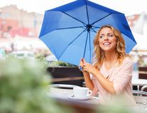 Beautiful girl with blue umbrella Stock Photo