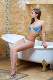 Beautiful girl in blue underwear in the bathroom Royalty Free Stock Images