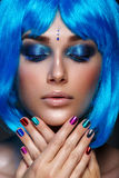 Beautiful girl in blue wig Stock Photography