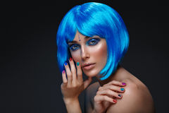 Beautiful girl in blue wig Stock Images