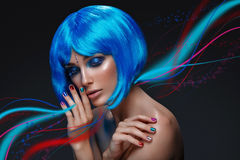 Beautiful girl in blue wig Royalty Free Stock Image
