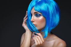Beautiful girl in blue wig Royalty Free Stock Photo