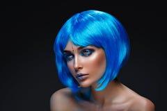 Beautiful girl in blue wig Stock Photo