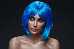 Beautiful girl in blue wig Royalty Free Stock Photos