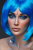 Beautiful girl in blue wig Royalty Free Stock Images