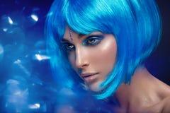 Beautiful girl in blue wig Stock Image