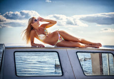 Beautiful girl by the boat stock photo