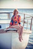 Beautiful girl by the boat Royalty Free Stock Photography