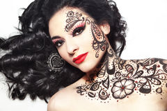 Beautiful girl with body art Stock Photo