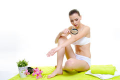 Beautiful girl body skin care concept with magnifier. Beautiful girl model on white with magnifier skin control concept stock photography