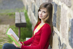 Beautiful girl with book Royalty Free Stock Photography