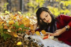 Beautiful girl with book in the autumn park Royalty Free Stock Images