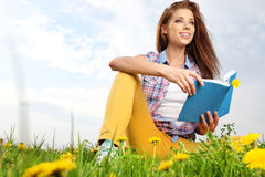 Beautiful girl with book Royalty Free Stock Photos