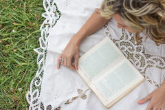 Beautiful girl with book on the grass Stock Photo
