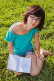 Beautiful girl with book on the meadow Stock Images