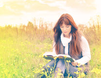 Beautiful girl with book outdoor Stock Image